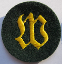 "WW2 German Army Wallmeister (Fortifications NCO) Sleeve Patch, Felt. Machine embroidered Gothic ""W"" on a dark blue-green wool disc There are slight variations of material backing, colour and embroidery style between these patches. Appears unissued, Exc."