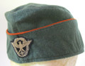 WW2 German Gendarmerie (Rural Police) Foreign Manufactured Wool Overseas Cap, with BeVo Fire-Police Eagle on the front, Orange piped lower scallop. No size markings, about a 58. Made of a more bluish-shade of Police-Green wool known to have been used by a factory in Antwerp, Belgium. A unique piece of history! VG+.