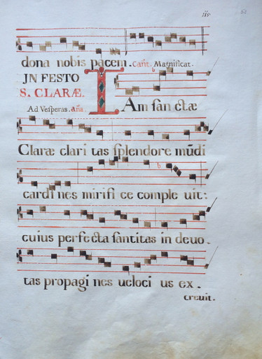 "M3853 A genuine leaf from a Franciscan Choirbook, manuscript on paper, Spain, ca. 1725. Latin text written in black ink in a large rounded bookhand, four-line staves and rubrics in red. From a monastery of St. Bernardino. Decorated initial ""I"" on recto painted in red and blue.  ""M"" on verso also in red and blue.   Size: 19 7/8 x 14 ¼ inches. Mat size: 24 x 18 inches."