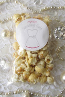 Poptique Popcorn's sweet, white Wedding Cake popcorn drizzled in vanilla icing and sprinkled with edible pearls and gems. The perfect party favor for your bridal shower or wedding reception!