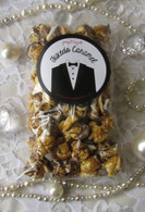 Poptique Popcorn's rich, buttery Tuxedo Caramel popcorn drizzled in luxurious heaps of both white and milk chocolate. The perfect party favor for your engagement party or couples shower!