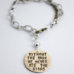 "The Signature Tag Bracelet-features a dangling handstamped tag with a variety of messages to choose from: ""She believed she could so she did,"" ""Why fit in when you were born to stand out,"" ""Without the dark we never see the stars,"" ""Dreams don't work unless you do,"" ""It was then that I carried you."""