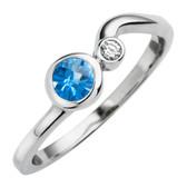 December birthstone, genuine Blue Topaz 4mm round set in 10kt white gold with a .03ct sparkling diamond.