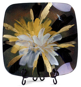 A square fused art glass platter featuring a black and reddish brown background, with yellow, white and gold blooms spraying from the center