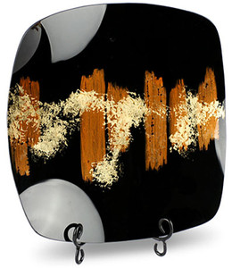 This square plate features black and orange patterns with hand painted gold highlighting