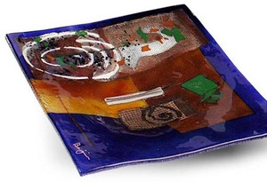 10 inch square blue glass platter featuring red and brown fused glass, touches of green and other colors and a white spiral