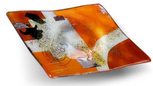 A 10 inch square bowled, decorative fused glass plate featuring orange, red and white with a combination of other color details