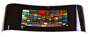 A rectangular platter dipped in its center in a gentle wave.  A multi-colored stained glass look