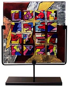 17 inch square decorative fused glass panel featuring multiple colors including black, red, blue, yellow and a combing effect.  A lot of action in this piece