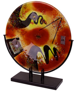 "From our Whirlwind Collection, this 15"" round platter features red, yellow and black fused glass on a decorative metal stand."