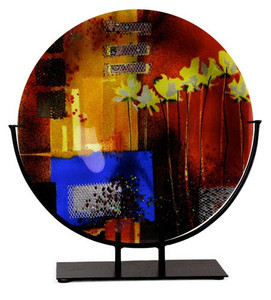 "15"" red fused art glass round platter, featuring a blue blocking, orange and black details and yellow flowers"