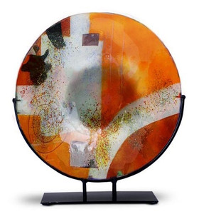 "Round 15"" fused glass platter featuring orange, red and white with black and hand painted metallic gold highlighting.  Abstract patterns"
