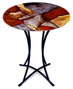 Abstract and contemporary mark the styling of this 20 inch round fused art glass cafe table.