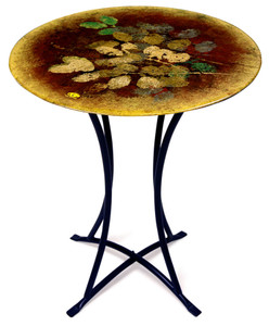 Autumn Leaves in gold bronze and green are delightfully added atop  a muted red bordered by gold in this cafe table