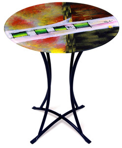 A broad white stripe with geometric green squares are features in this fused glass patio cafe table