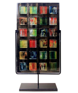 A tall, rectangular fused glass decorative panel featuring a number of small colored glass squares.  Stand included