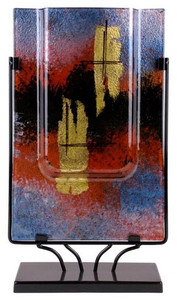 Rectangular vase featuring fused glass in blue, red and black, with metallic gold hand-painted detail markings.  Stand included
