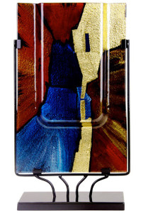 """An 18"""" rectangular vase with sprays of blue, red and black from the center, and hand painted metallic gold from the top down on one side"""
