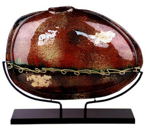 This 19 inch fused glass oval vase hand black, red and gold, and is in the Maroon Vines series.  Stand included