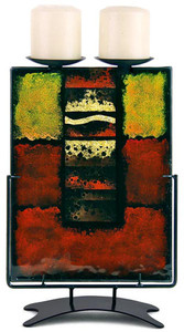 This contemporary column double candle holder in fused glass is a study in red and yellow with black framing and hand painted metallic gold details.  Stand included