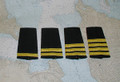 Epaulet with stripes only.