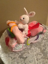 Everything you need for new born Baby: Diapers, Pacifier, Bibs, Receiving blankets, and stuffed animal. For Girl