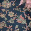 Brocade PP multi colored flowers on a dark blue background