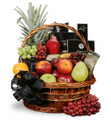 Basket with fresh fruit and gourmet treats