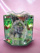Glass elephant oil burner with dimmer switch to control light.