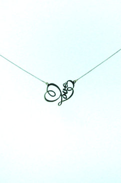 Love with a Heart in Rolling Script, on 18 inch chain. Sterling Silver.