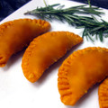 Tender thigh meat chicken seasoned in Southwest spices and paired with fire roasted vegetables, packed into our empanada dough.   Units/case:100