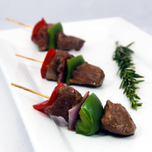 Tender, marinated pieces of beef tenderloin paired with red and green peppers and red onion, presented on a skewer.   Units/case: 100