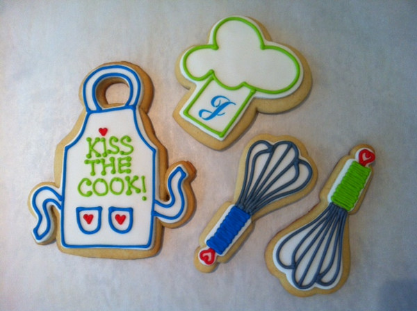 Decorated cookies (apron, chef's hat, wire whisk) by Jen McMenamin contact her at: jen_mcmenamin@yahoo.com or info@cowspingsbakery.com