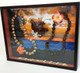 A customer's photo was enlarged and used as the background in this shadowbox.