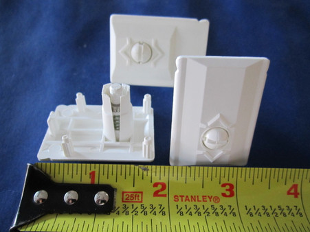 """Bottom Cap with Adjustable Button Catch.  For hollow core shutters.  Measures: 1 1/4"""" x 1 3/4"""" Price listed is for 1 cap."""