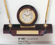 "Clock and pen set rosewood piano finish, 5"" tall x 9"" wide, with 2 quality pens."