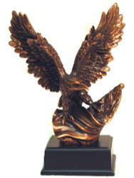 "EAGLE METAL CLAD 10"" TALL WITH A 7"" WING SPAN ATTACHED TO BLACK BASE."