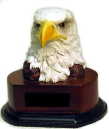 "6-1/2"" TALL HAND PAINTED EAGLE HEAD MOUNTED ON WALNUT FINISH BASE."
