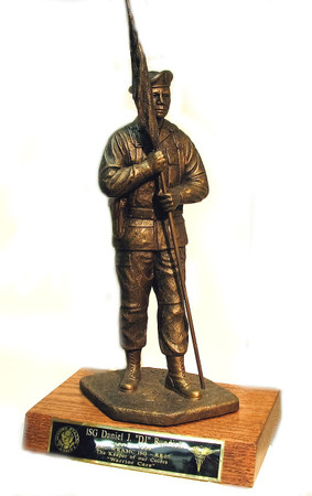 "22"" TALL ARMY FIRST SERGEANT STATUE MALE MOUNTED ON 8"" WIDE X 12"" LONG X 1-1/2 HIGH GENUINE REDWOOD BASE."