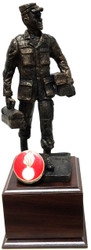 "19"" TALL ARMY OR AIR FORCE MECHANIC STATUE MOUNTED ON LAMINATED CHERRY WOOD BASE."