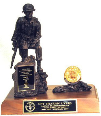 """11"""" TALL IRON MIKE MILITARY STATUE MOUNTED ON 8"""" X 12"""" GENUINE WALNUT BASE. ARMY MEDALLION IS INCLUDED. CUSTOMER CAN PROVIDE ADDITIONAL COINS FOR MOUNTING IF REQUIRED."""