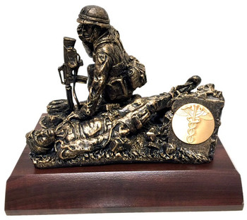 """9"""" tall, 10"""" long, 7"""" wide male Combat Medic military statue mounted on a 8"""" x 11"""" x 1-1/2"""" laminated cherry base.  """"Calling Dustoff""""  Also available on female version. Unit logo coin can be mounted on the small plate holder on the statue."""