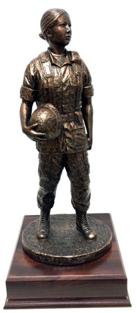 "18"" tall military statue ""Woman in Arms"" mounted on a 7""wide x 7"" long X 2"" high laminated cherry base."
