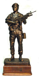 "19"" tall Military Statue of a Soldier Holding a Rifle, highly detailed, mounted on a 6"" x 6"" walnut base."