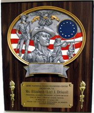 "Awesome laminated cherry plaque 10-1/2"" x 13"" with oval National Guard Minuteman plate and two torches."