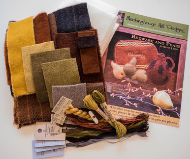 """Complete kit - pattern, fabrics, threads, freezer paper and wool batting.  All you need are scissors, chenille needles, pins and a pencil to stitch this antique design.  This pattern also includes a 16"""" x 12"""" printed pattern for using to rug hook this design as well!"""