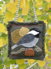 Make Chester the chickadee into a door hanger, ornament or pin cushion!  Kit includes pattern, felted wools, hand-dyed applique threads, green prairie cloth background and backing, freezer paper and ribbon hanger.