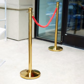 "Lancaster Table & Seating 40"" Gold Rope-Style Crowd Control / Guidance Stanchion Set with 5' Red Rope"