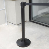 "Lancaster Table & Seating Black 36"" Crowd Control / Guidance Stanchion with 78"" Retractable Belt"