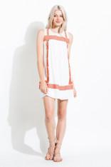 white dress burnt orange embroidery